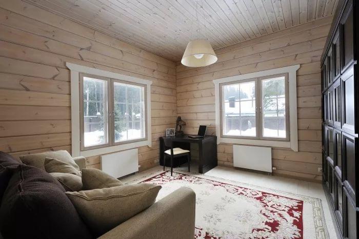 Вариант оформления гостинной в деревянном доме скандинавского стиля