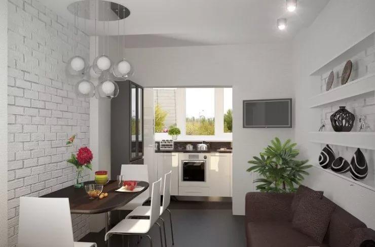 Вариант размещения мебели на кухне совмещенной с балконом