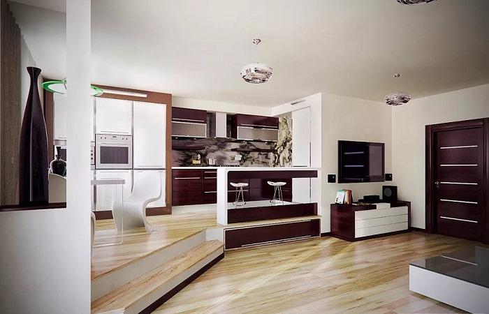 Кухня на подиуме в интерьере совмещенной гостиной