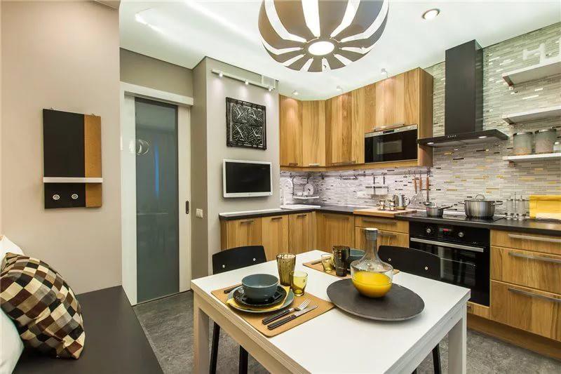 Обеденный стол в интерьере кухни 12 кв.м.