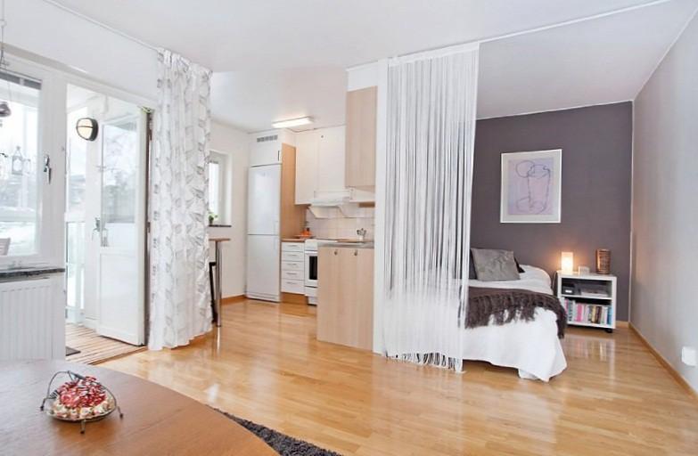 Функциональные зоны в объединенной с кухней однокомнатной квартире